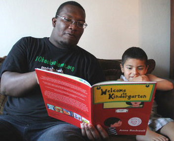 Jose and his Role Model Jonathan reading together